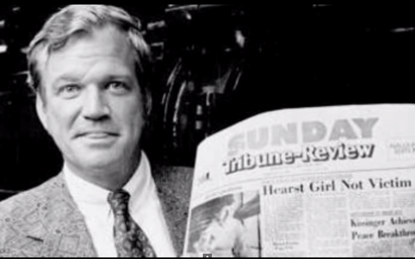 Billionaire Richard Mellon Scaife with a Sunday copy of the Tribune-Review